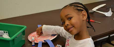 Little Girl Making Paper Plate Crafts